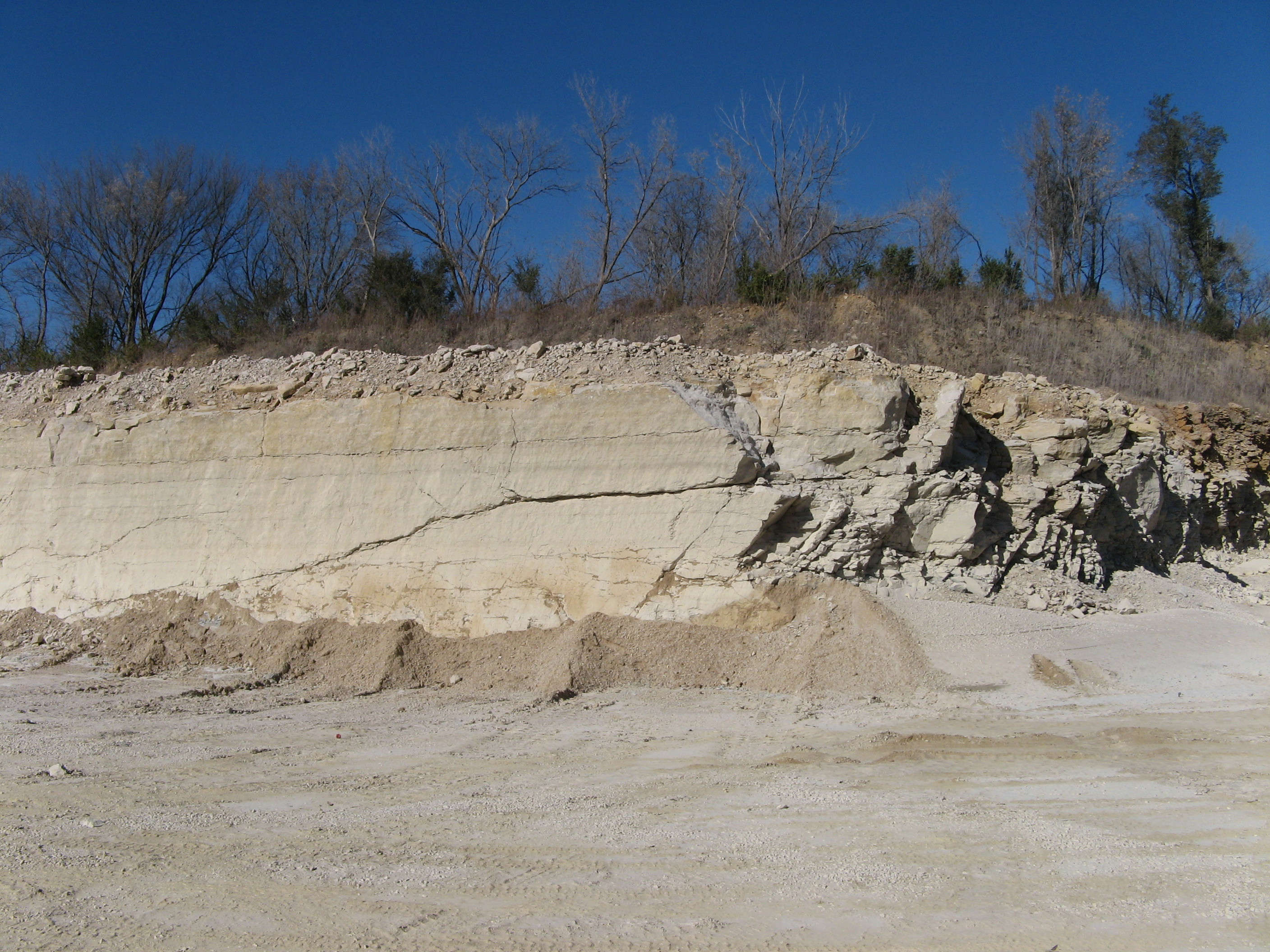 Small piles of crushed Devonian age agricultural limestone in 2011 from Bloom Quarry near Jesup in Buchannan County, Iowa.