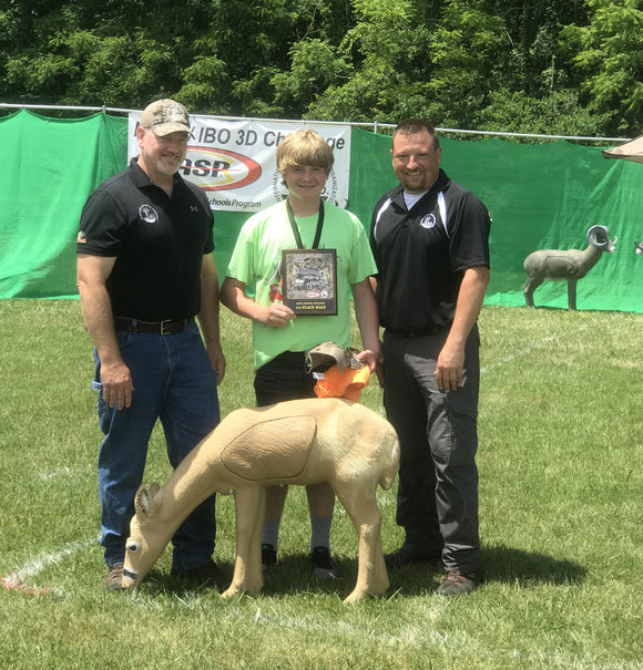 Logan Kelly, (center) from Mount Vernon, scored the first perfect round in a national 3D archery competition. Kelly is joined by Bryan Marcum, IBO president (left) and Ryan Bass, with the IBO 3D Challenge (right).