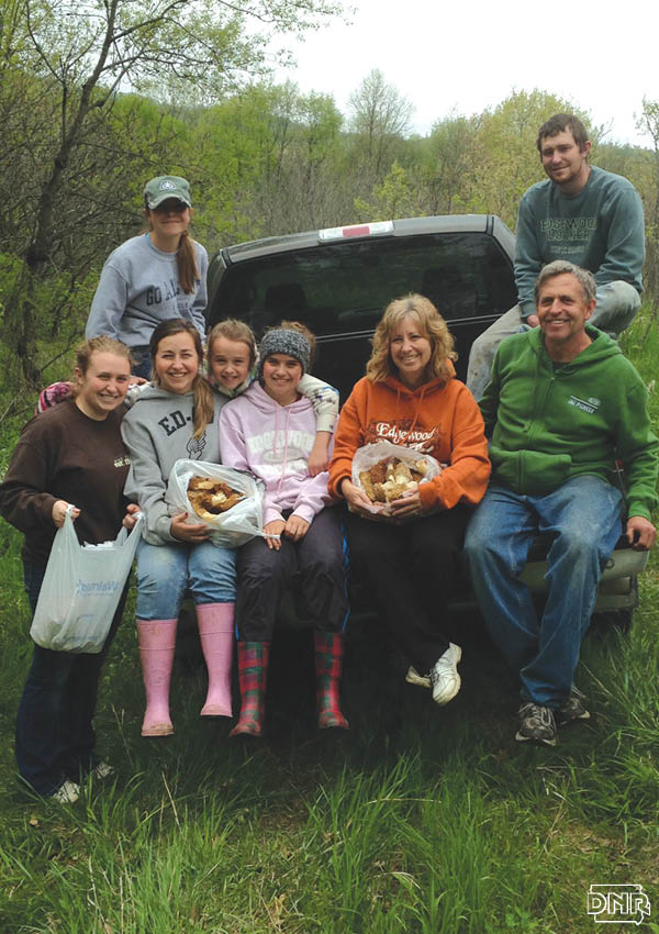 Jim and Jody Kerns' belief in conservation and education is as deeply rooted as the trees that protect the banks along their Volga River property. Jim and Jody with their 6 children mushroom hunting | Iowa DNR
