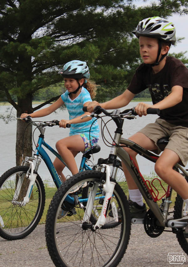 Simple steps can improve air quality and help protect the outdoors for those with developing lungs, like kids riding bikes | Iowa DNR