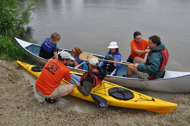 outfitter helps paddlers gear up before paddling