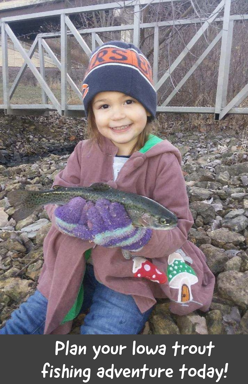 girl holding a trout caught at the kids trout fishing pond at the Bellevue Station