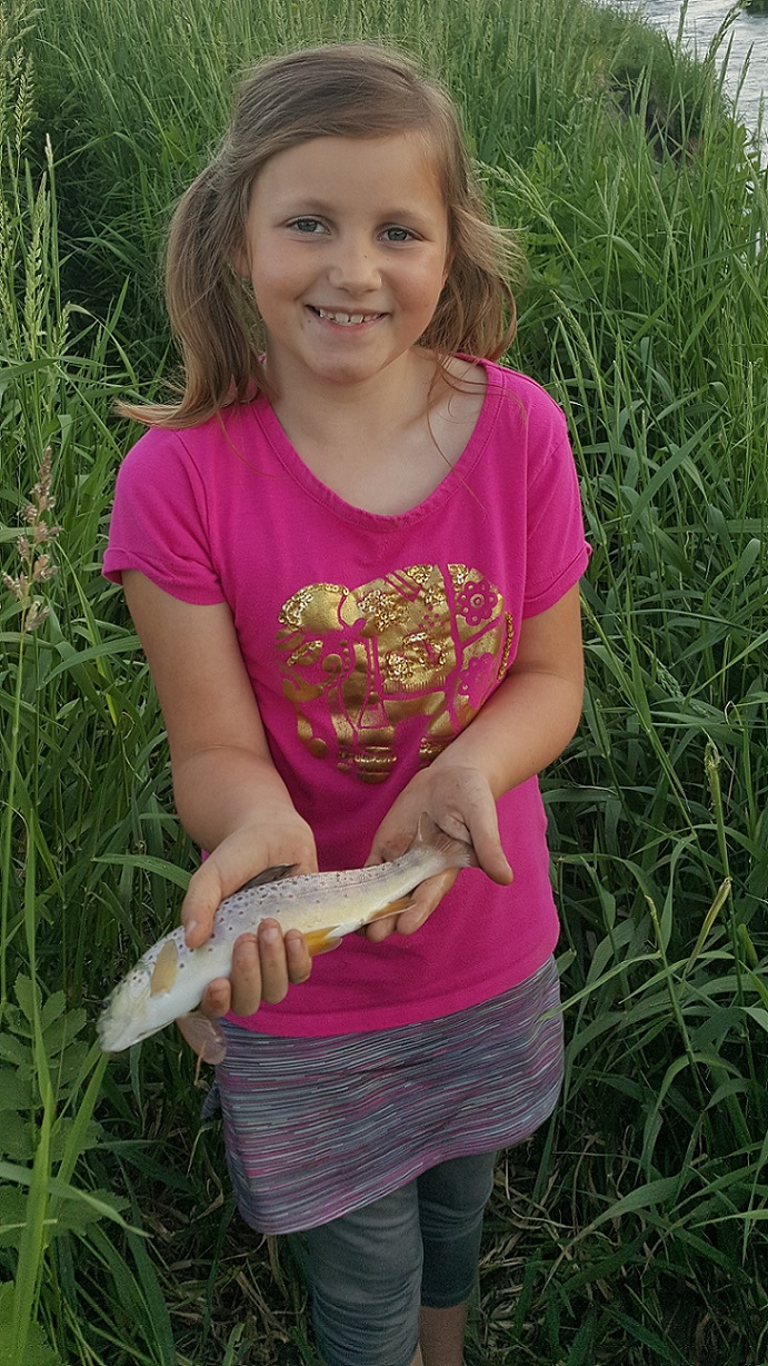 girl holding a trout from a Northeast Iowa stream