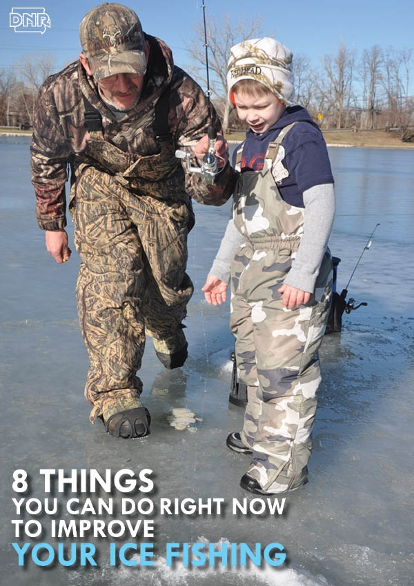 A man and boy ice fishing.