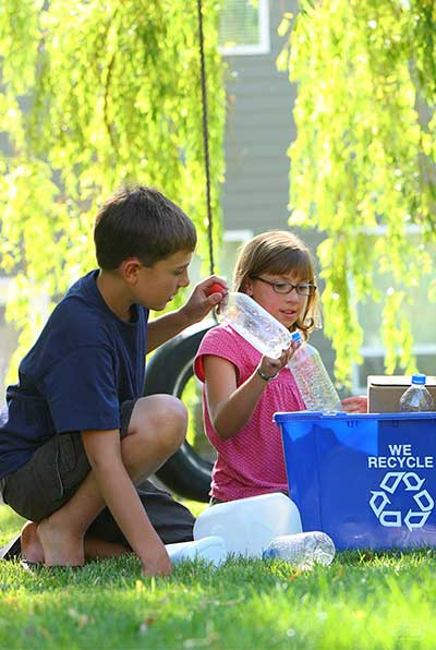 photo of kids recyling