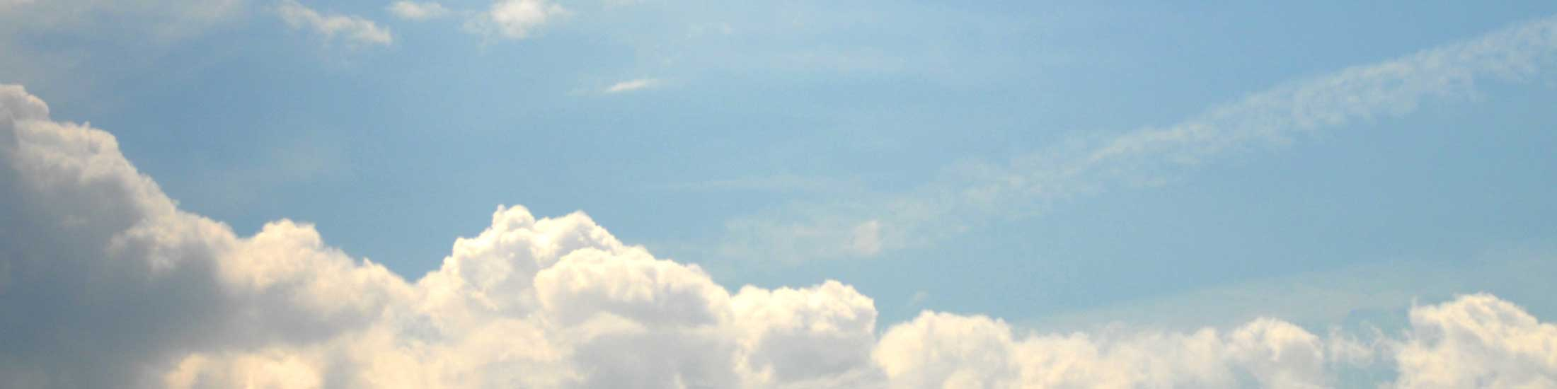 banner image of a blue sky with clouds
