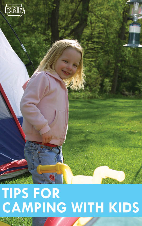 Girl outside of tent