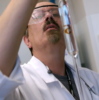 A professional lab technician analyzing a water sample